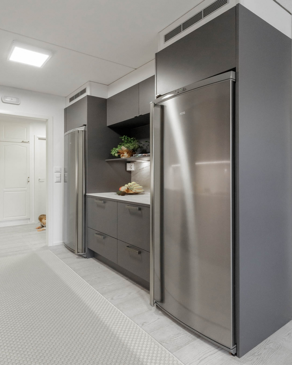 Miinus eco friendly matt grey modern galley kitchen aeg appliances