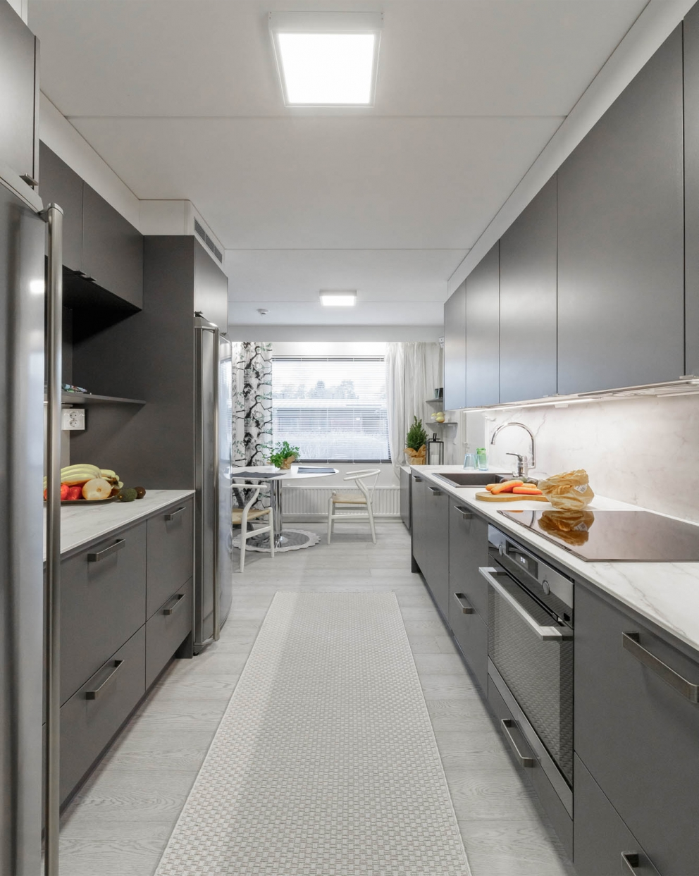 Miinus eco friendly matt grey modern galley kitchen length view