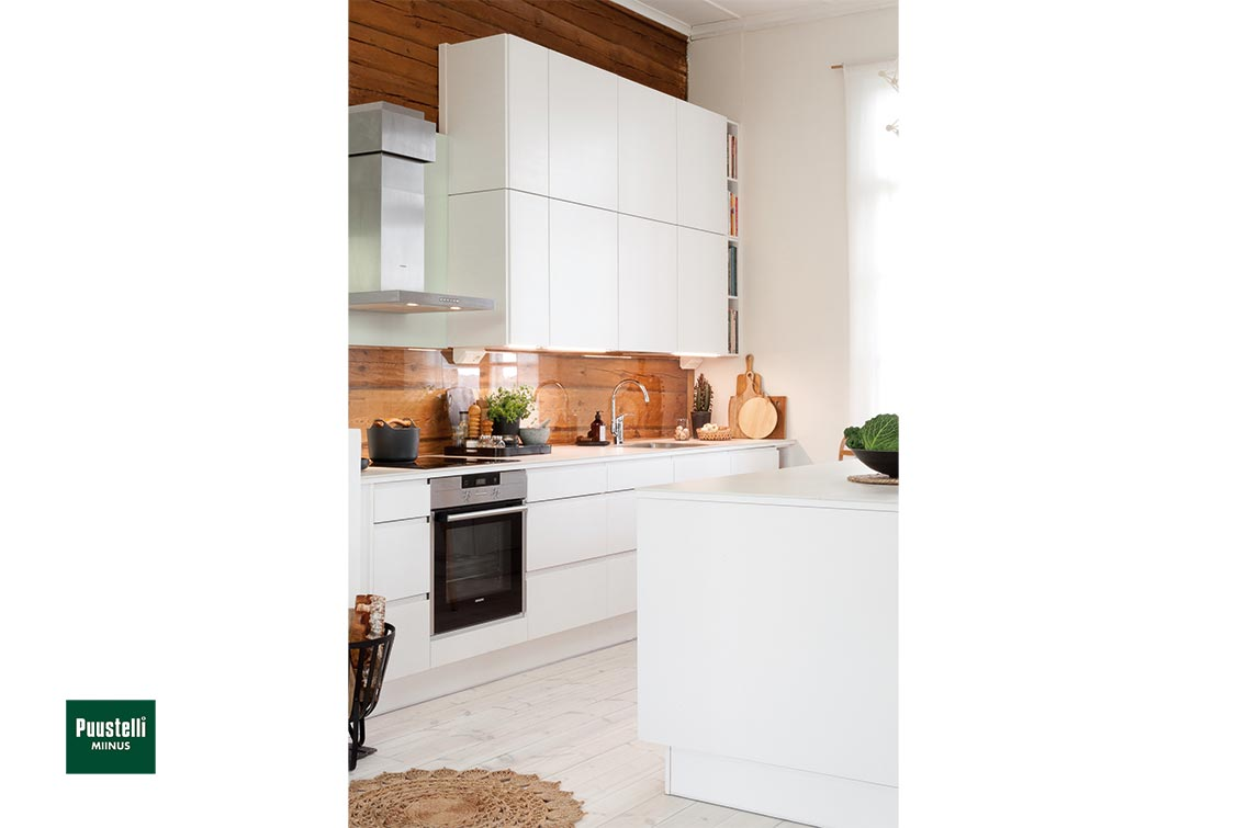 Puustelli Miinus white ecological handleless kitchen angle showing height of wall units