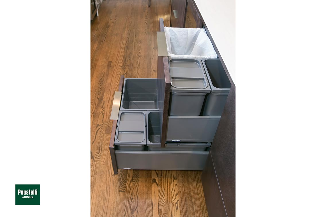 Puustelli Miinus ecological kitchen showing open recycling centre drawers