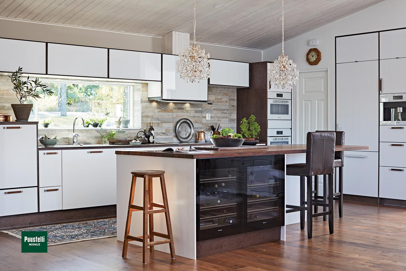 Puustelli Miinus ecological kitchen in white and lacquered dark brown birch veneer island view