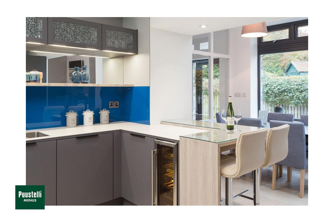Puustelli Miinus eco-friendly kitchen with dove grey painted birch veneer doors peninsula