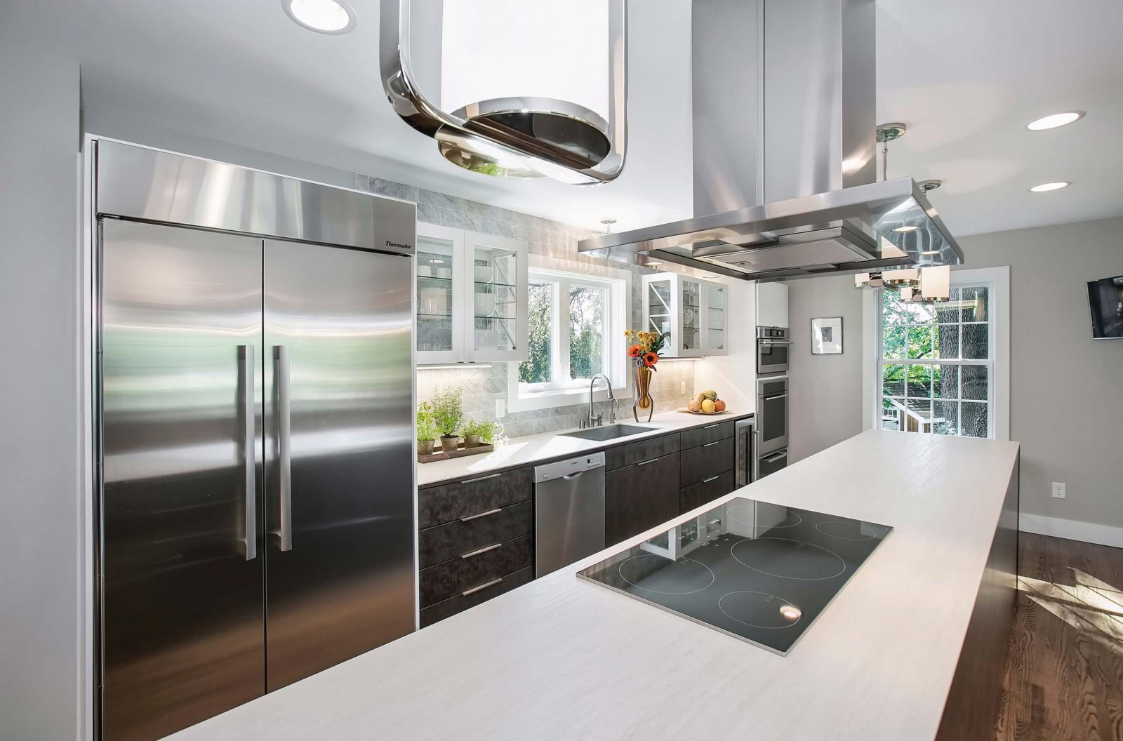 Miinus eco-friendly kitchen brushed steel effect units stainless steel appliance and white ceramic worktops