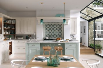 Traditional in-frame painted shaker kitchen green units white granite tops