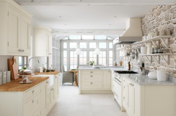 Traditional in-frame cream painted oak shaker kitchen with wood and granite